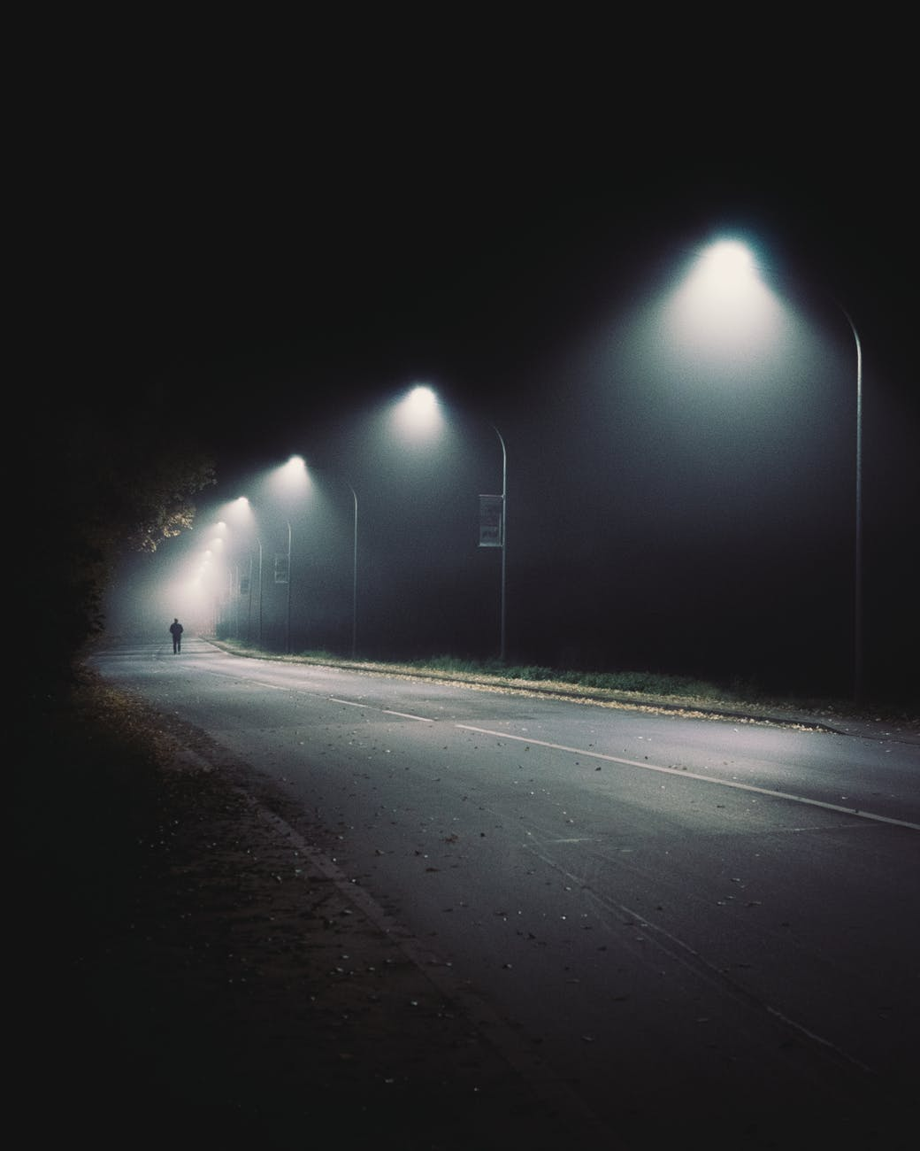 man walking on the empty street